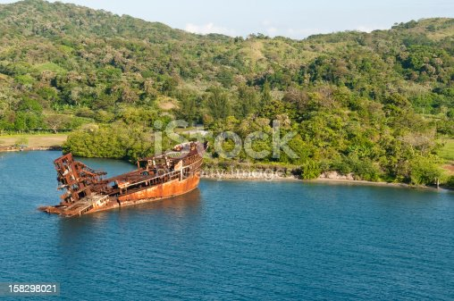 The rusty hulk of a ship run aground on the island of Roatan, Honduras