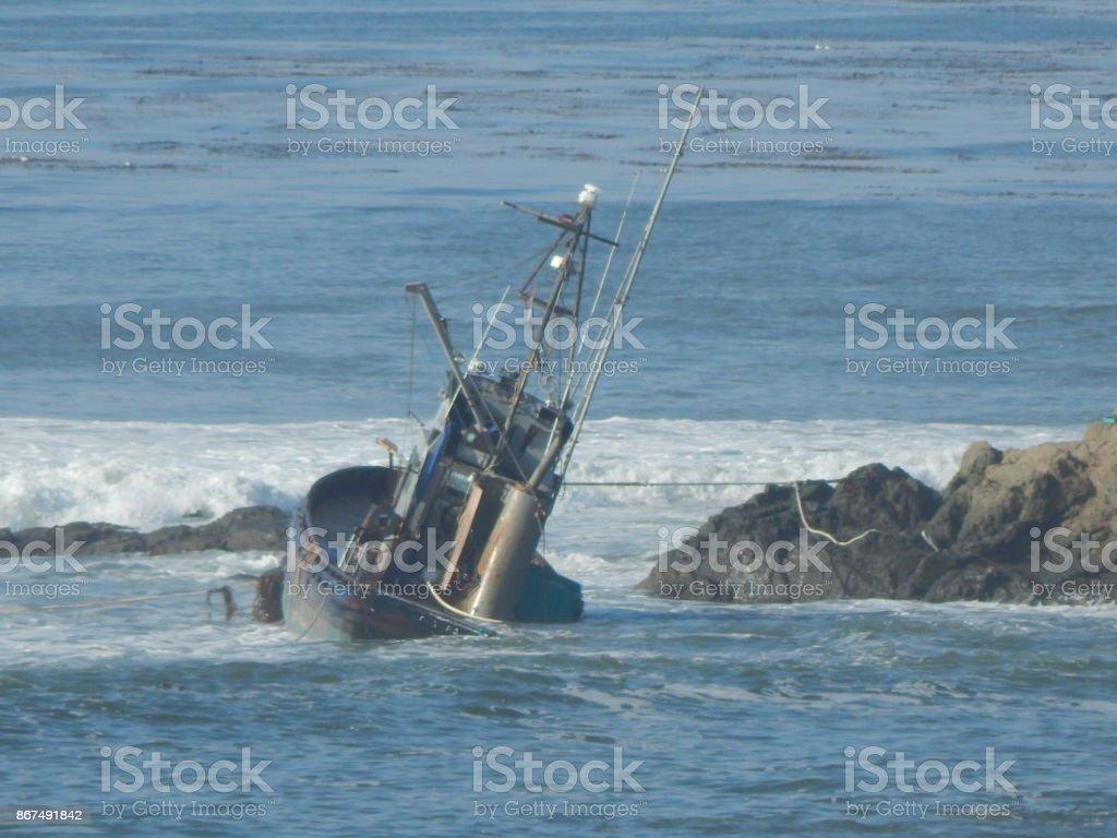 Shipwreck sinking stock photo