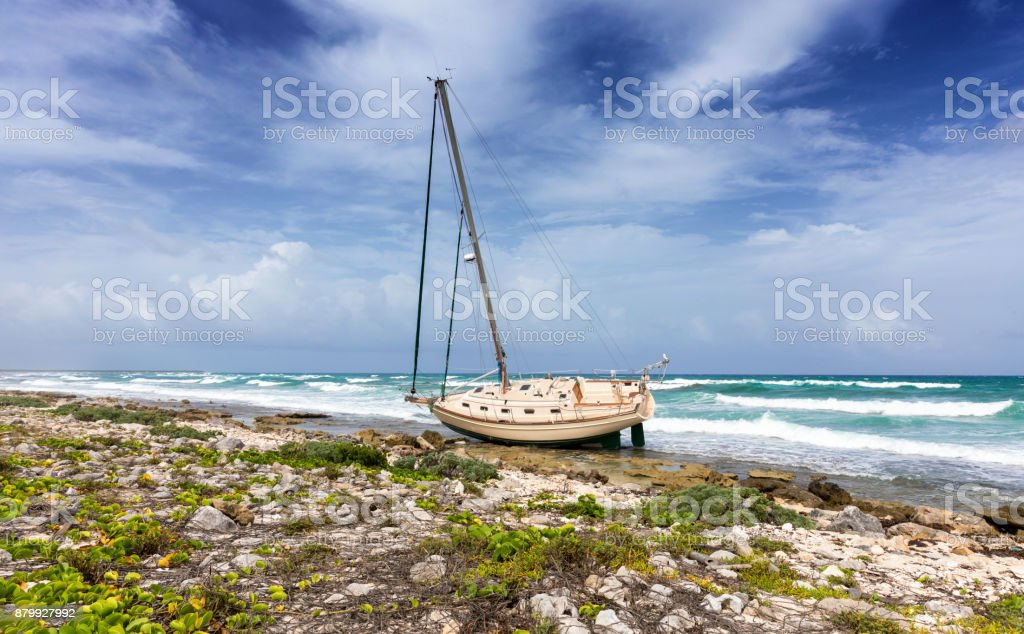 Shipwrecked sailing boat stock photo