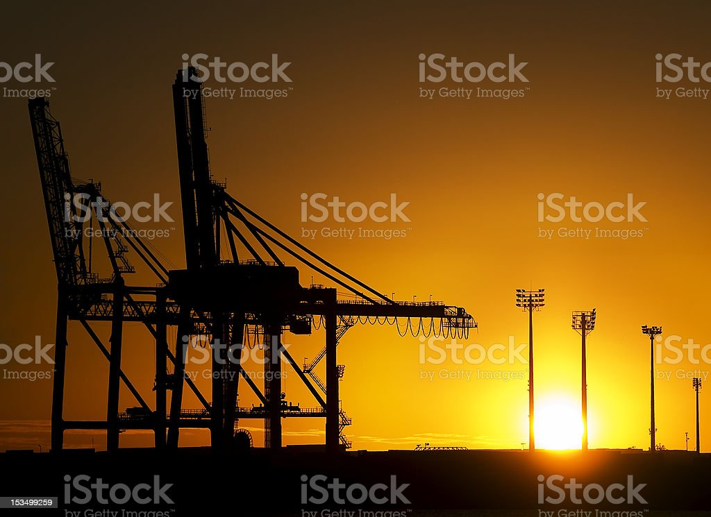 Shipyard Cranes at Sunrise stock photo