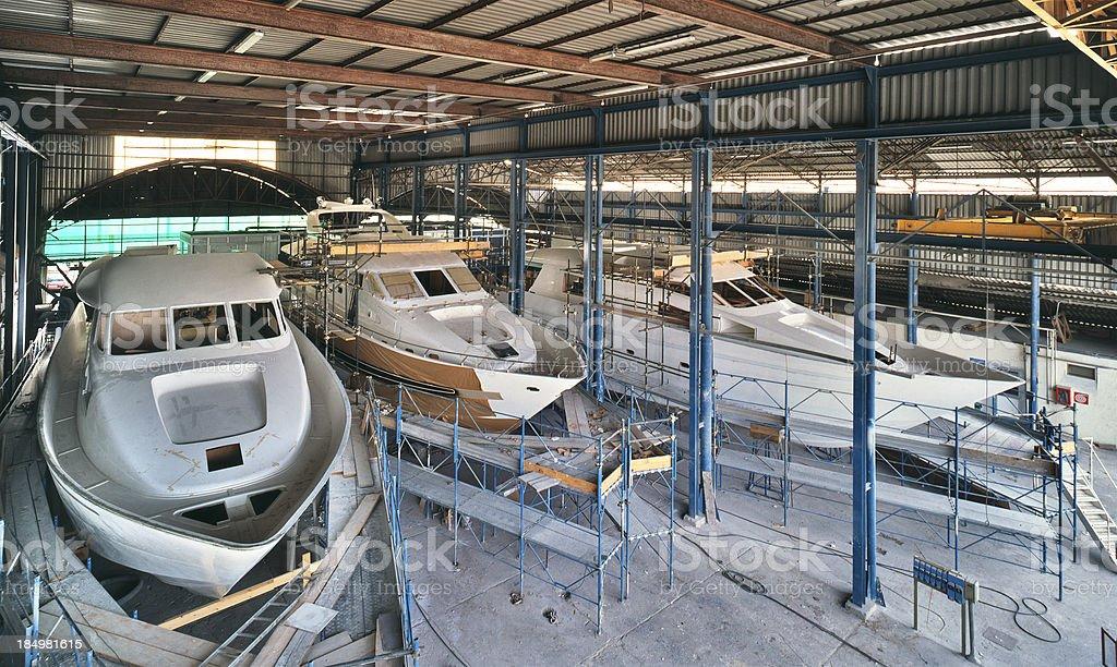 Shipyard in Viareggio, Italy, three yachts under construction, marine industry stock photo