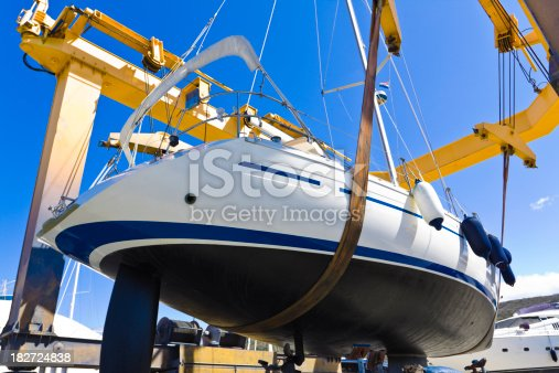 large shipyard crane lifting sailboat for a launchCHECK OTHER SIMILAR IMAGES IN MY PORTFOLIO....