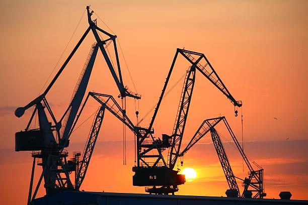 shipyard sunset - aleks66 stock pictures, royalty-free photos & images