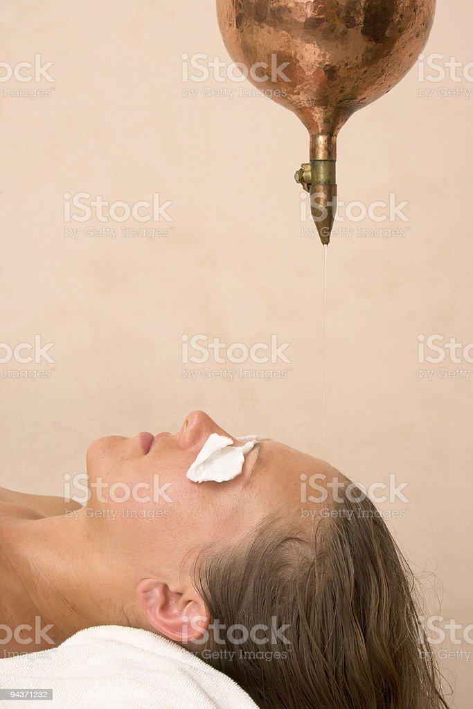 Shirodara oil treatment in spa royalty-free stock photo