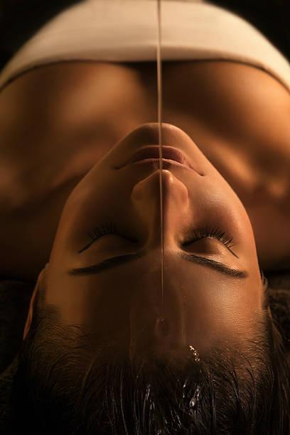 Shirodhara massage - close-up stock photo