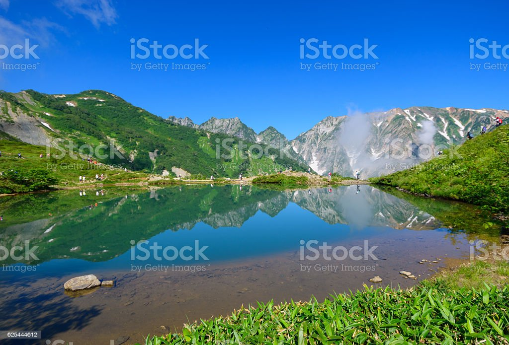 Shirouma mountains and Happo-ike Pond at Happo-one in Hakuba, Nagano stock photo