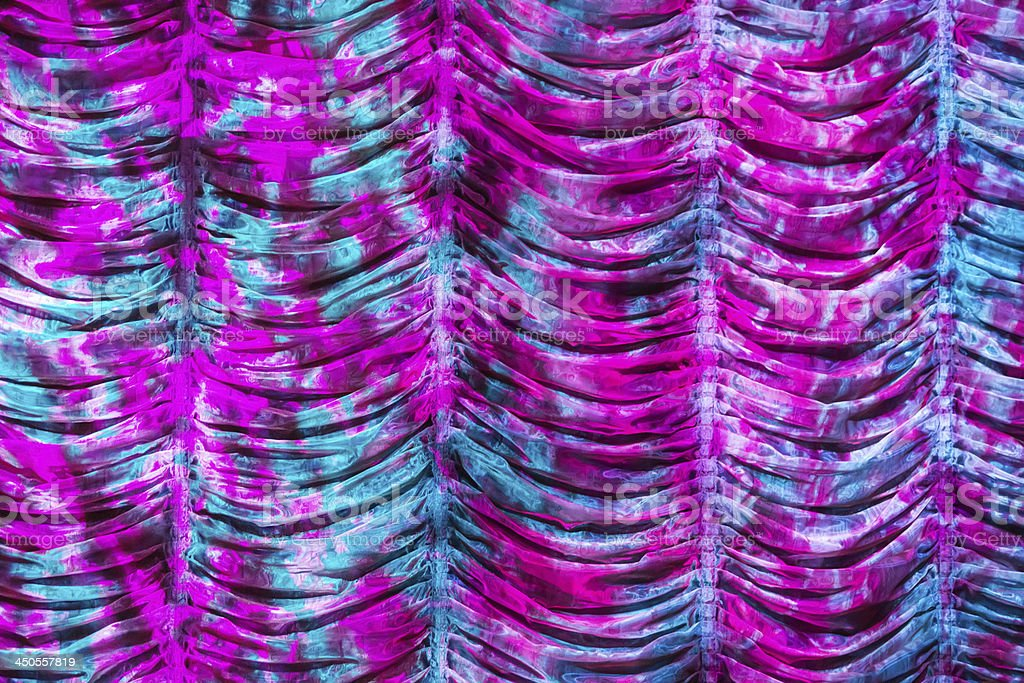 Shirred Theater Stage tie dyed curtain background stock photo