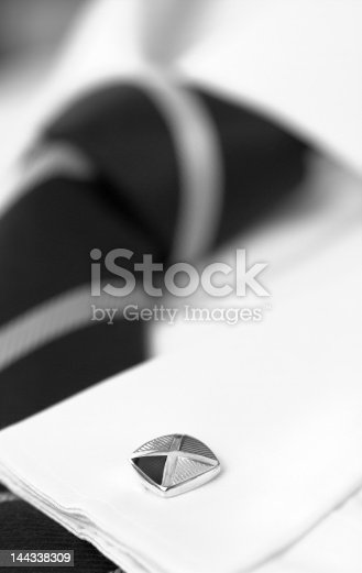 MenAAs white shirt with striped tie and cufflink