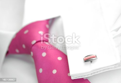 MenAAs white shirt with spotted tie and cufflink