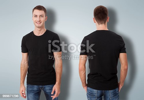 istock Shirt design and people concept - close up of young man in blank black t-shirt isolated. 999671296