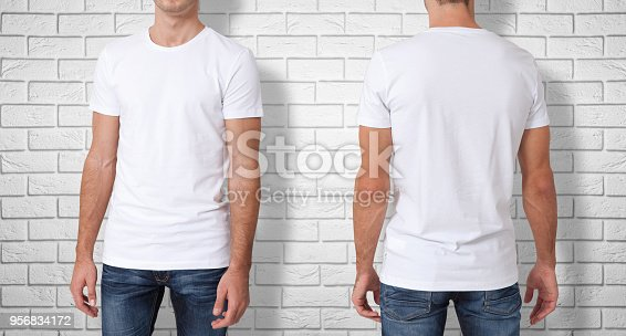 istock Shirt design and people concept - close up of young man in blank white t-shirt isolated. 956834172