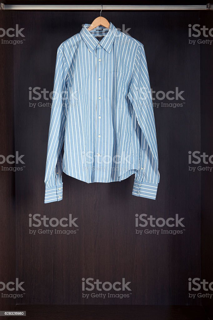 Shirt hanging in closet stock photo