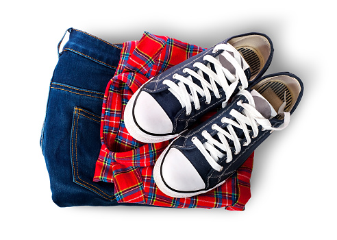 Shirt jeans and sports shoes stock photo
