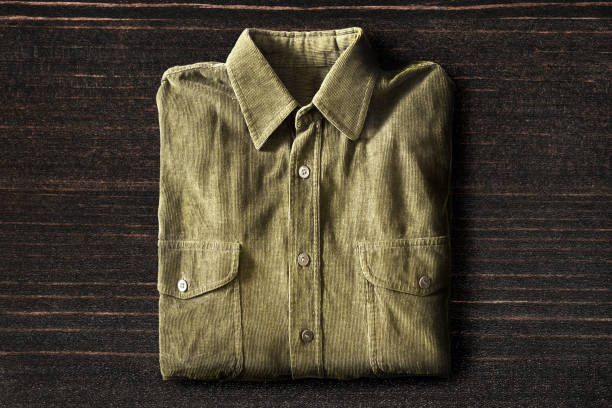shirt on wooden background - corduroy stock pictures, royalty-free photos & images