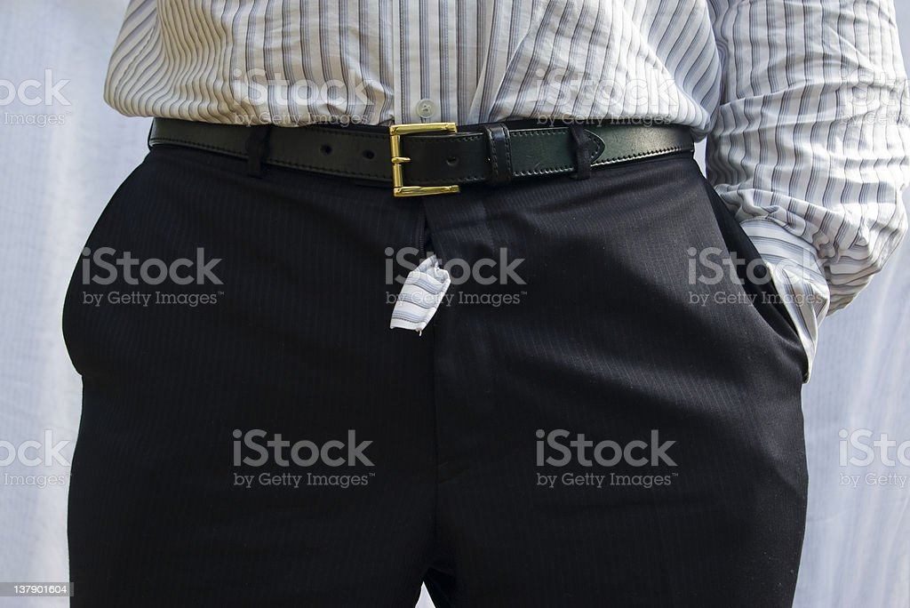 Shirt poking out of suit trousers stock photo