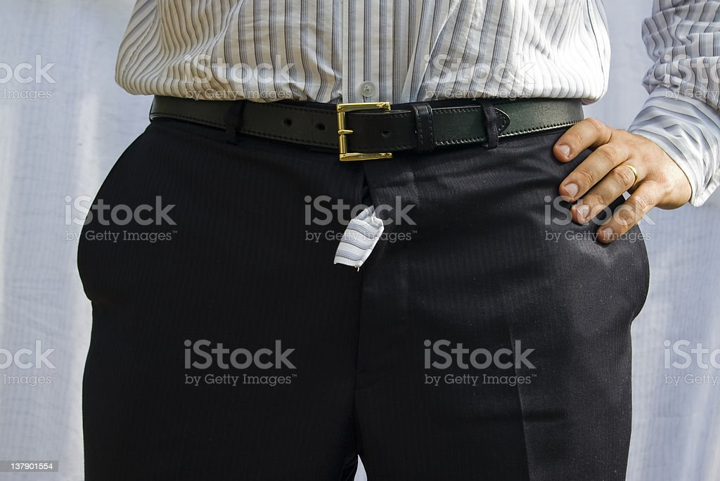 Shirt poking out of suit trousers zipper stock photo