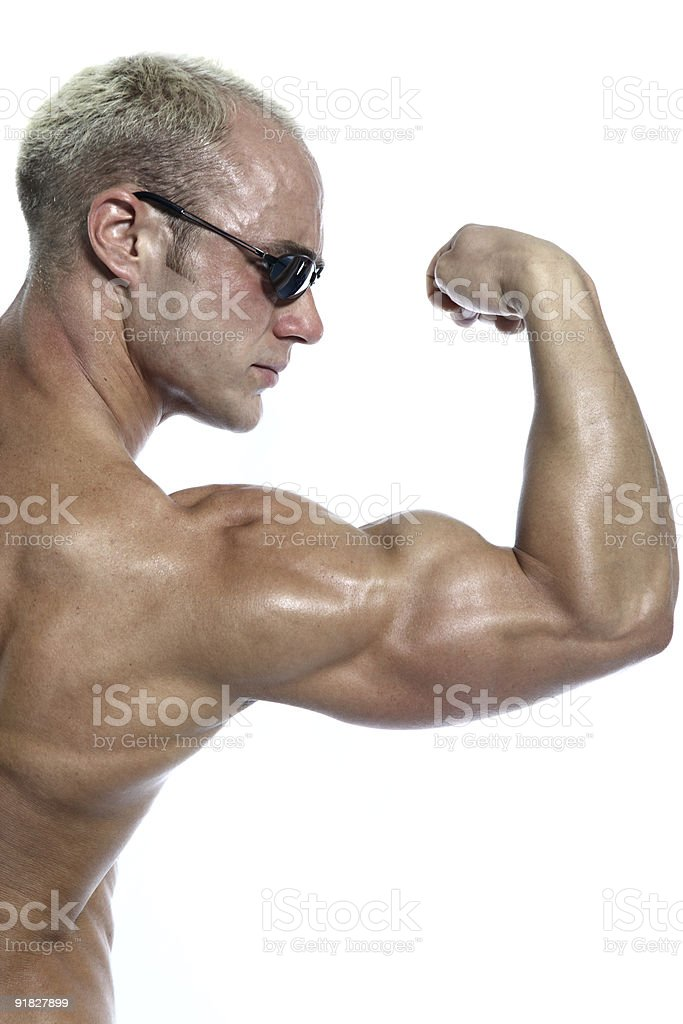 Shirtless bodybuilder posing stock photo