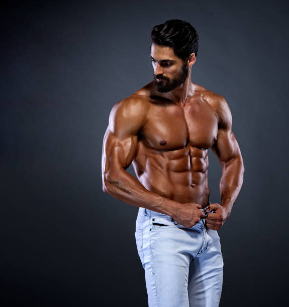 Shirtless Handsome Young Men Shirtless Handsome Young Men Posing in Jeans shirtless male models stock pictures, royalty-free photos & images