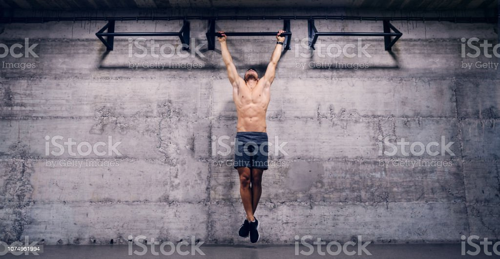 Shirtless Man Doing Pull Ups In The Gym When You Lose All