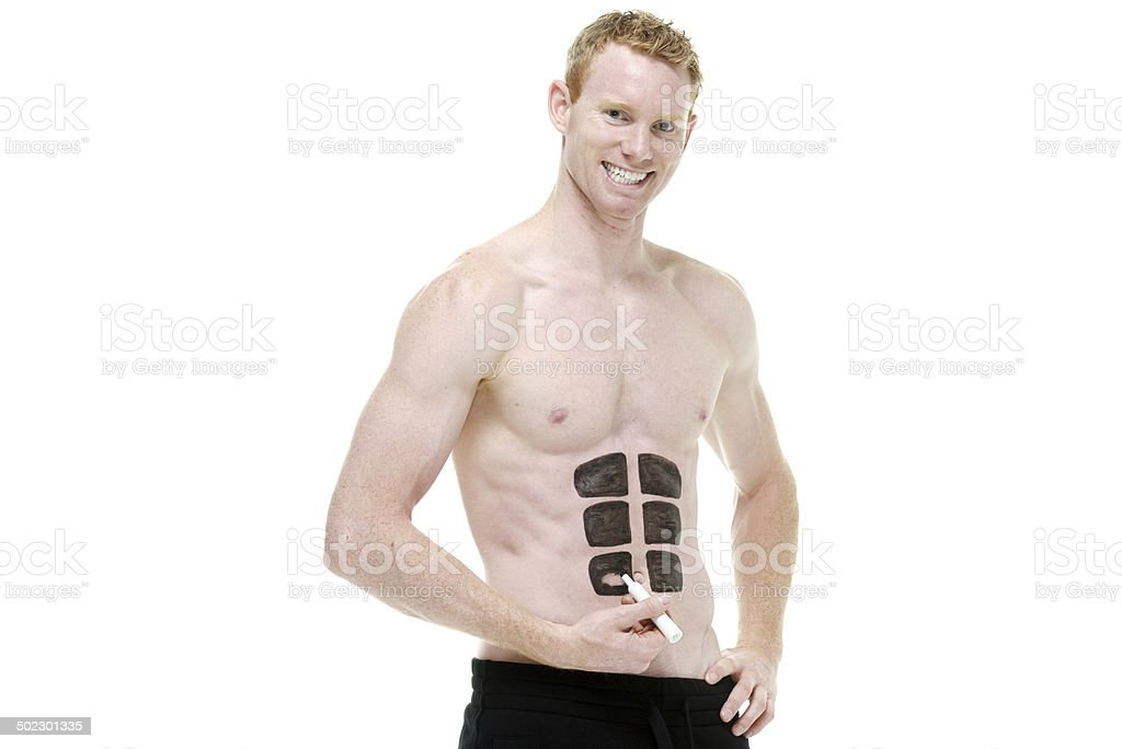 Shirtless man drawing a fake six pac royalty-free stock photo
