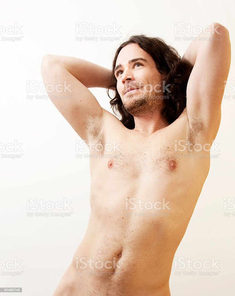 Shirtless man in extension looking up royalty-free stock photo