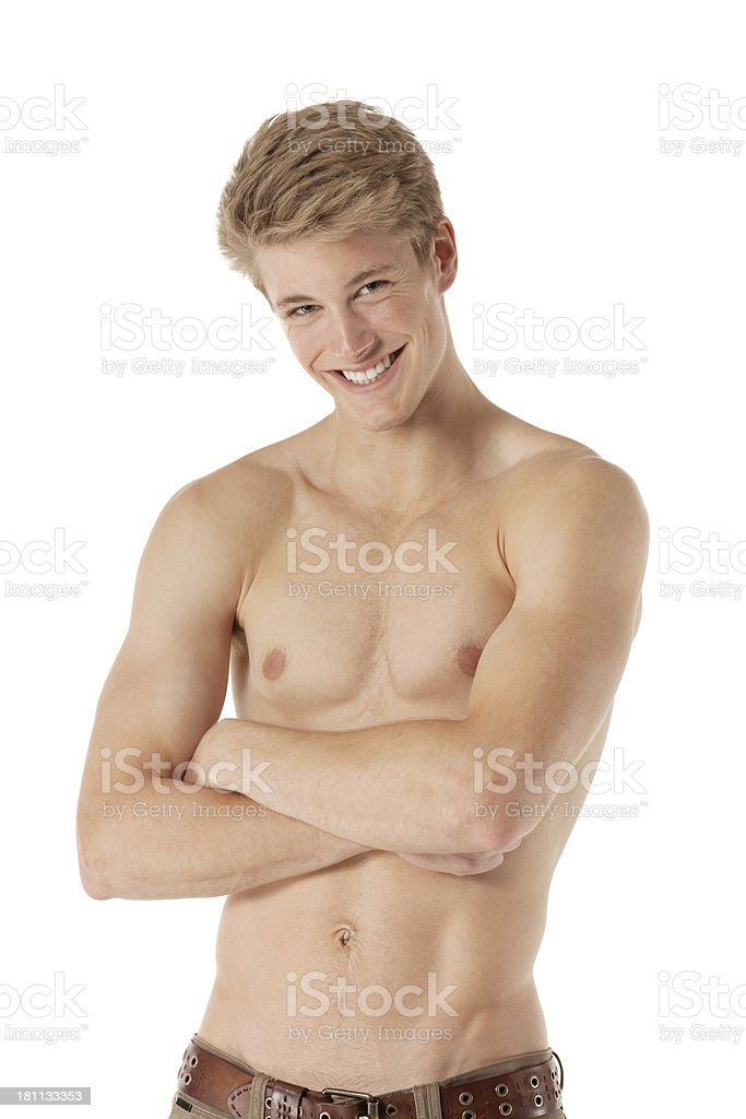 Shirtless man posing with arms crossed royalty-free stock photo