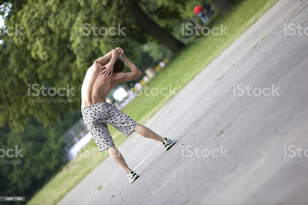 Shirtless man   stretching before running in a park royalty-free stock photo