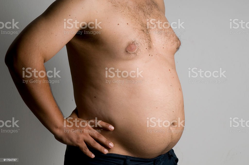 A shirtless man with a big belly stock photo