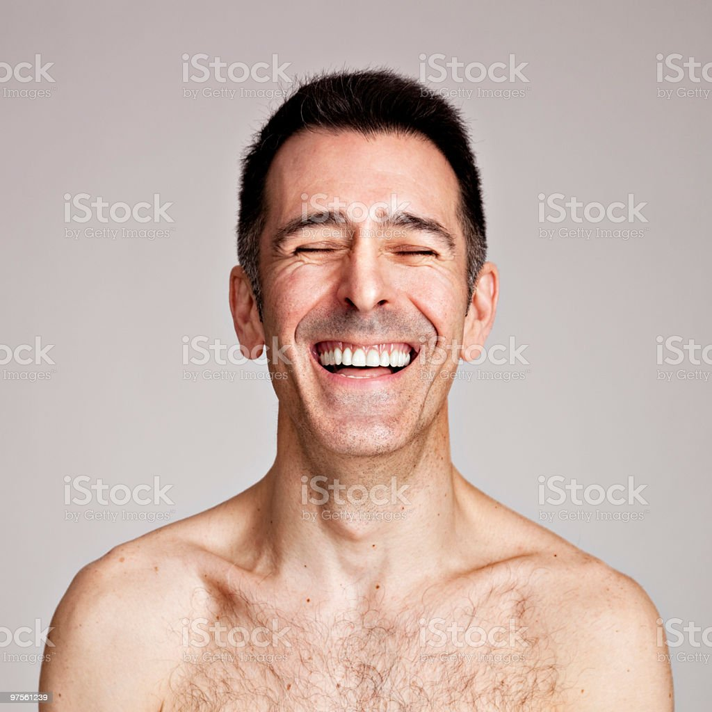 Shirtless mature man bursting with laughter royalty-free stock photo