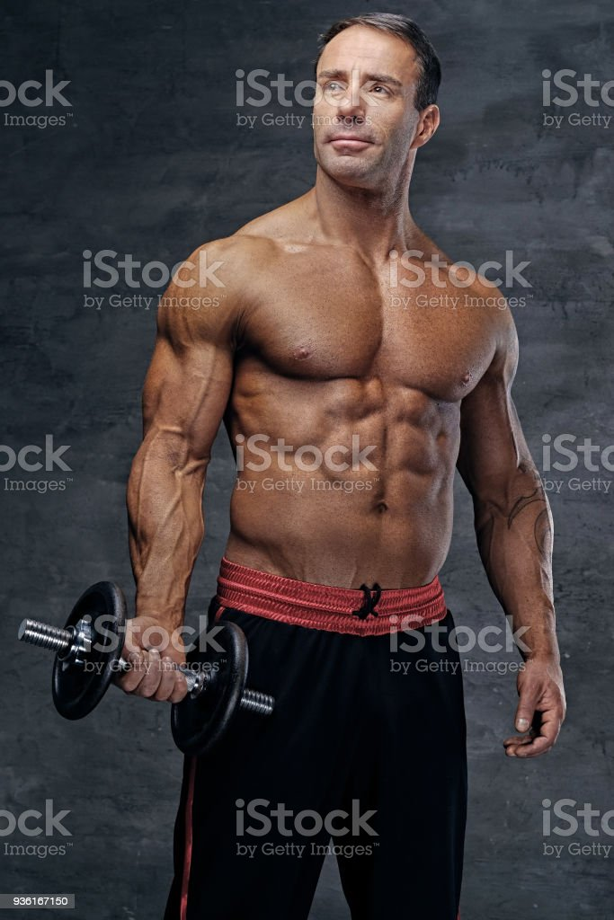 Shirtless Middle Age Male Holds Dumbbell Stock Photo