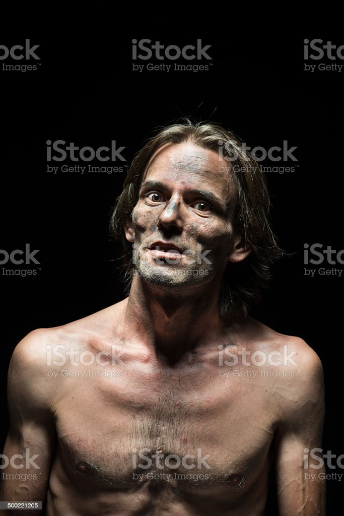 Shirtless murderer with pyscho expression stock photo