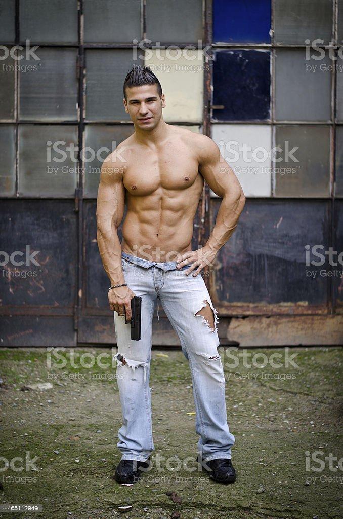 Shirtless, Muscular Latino Young Man Holding Gun Royalty