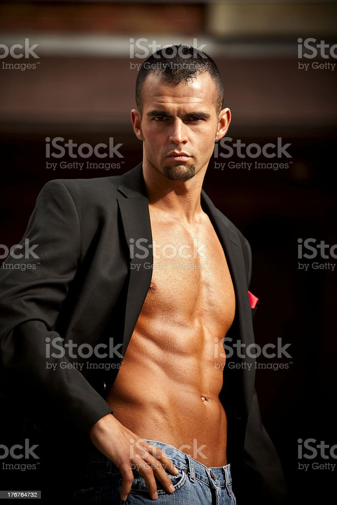 Shirtless Muscular Male in Suit Jacket royalty-free stock photo