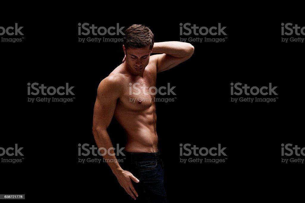 Shirtless muscular man giving a pose stock photo