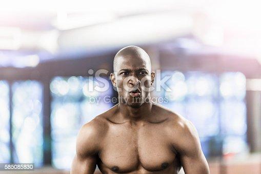 1069872470 istock photo Shirtless muscular man in health club 585085830