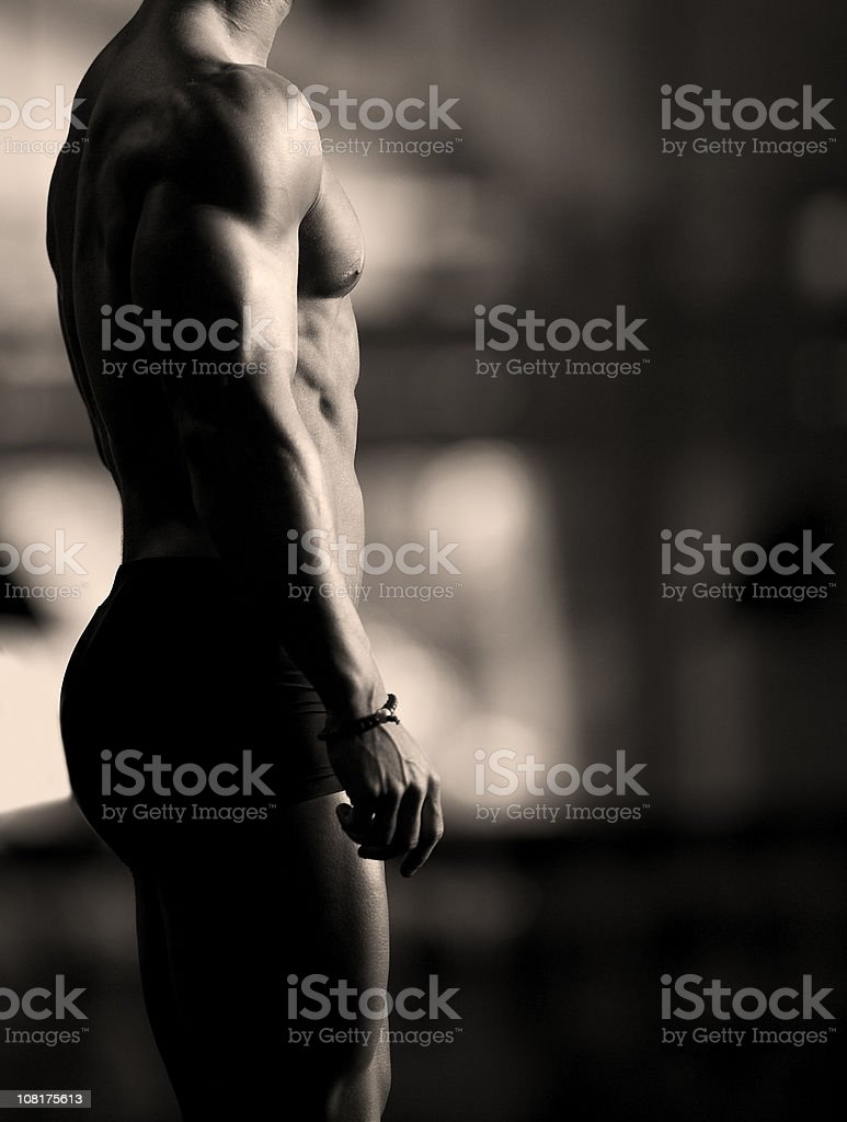 Shirtless Muscular Man Profile, Sepia Toned royalty-free stock photo