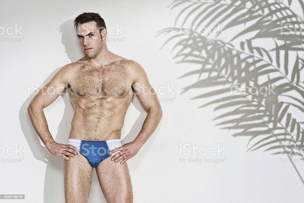 Shirtless muscular man standing & looking at camera royalty-free stock photo