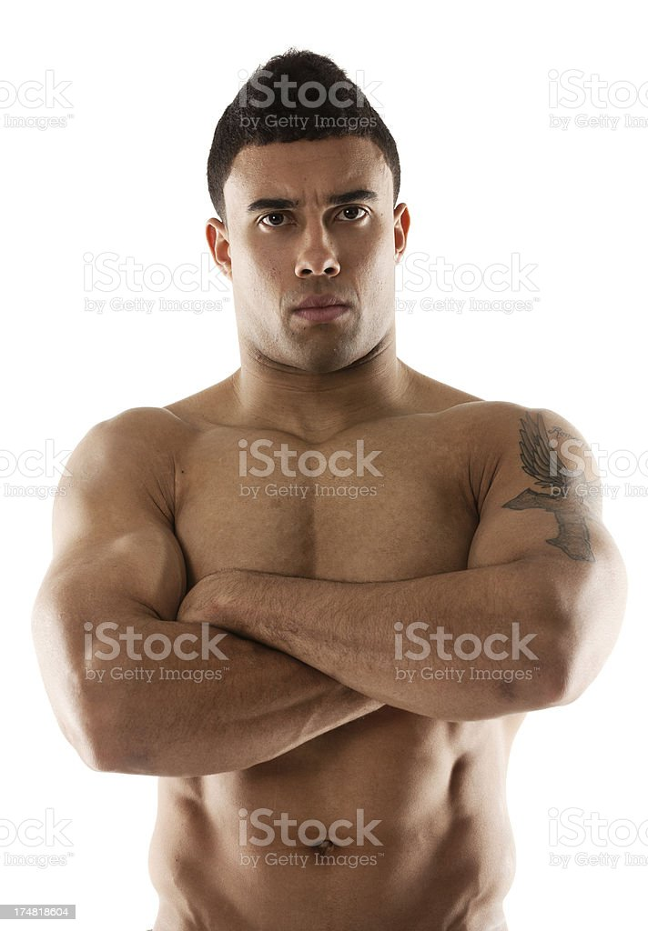 Shirtless muscular man with arms crossed royalty-free stock photo