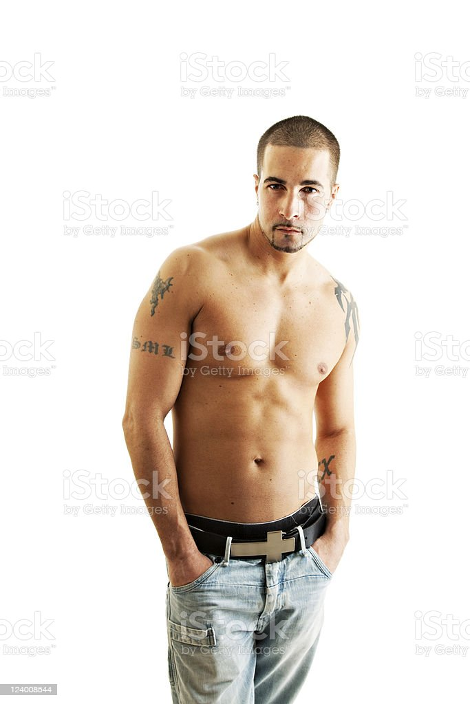 Shirtless muscular tattooed young man looking seductive royalty-free stock photo