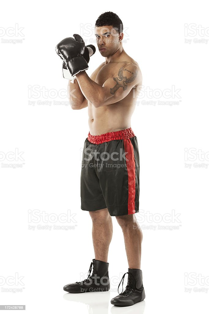 Shirtless young boxer standing royalty-free stock photo