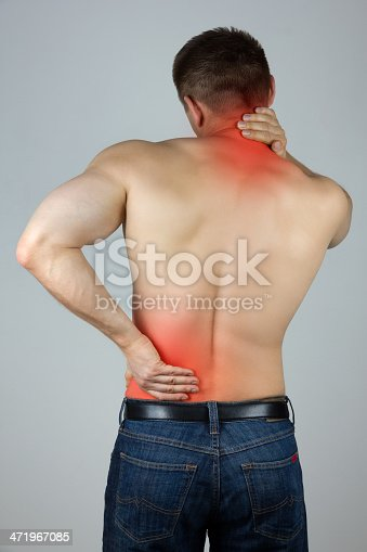 istock Shirtless young man rubbing lower back and neck in pain 471967085