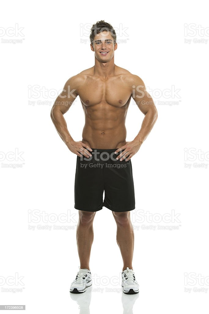 Shirtless young man with hands on hips royalty-free stock photo