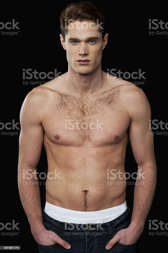 Shirtless young masculine man stock photo