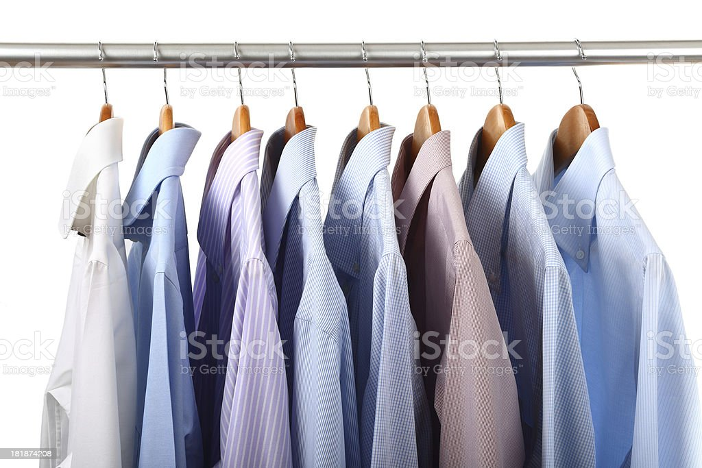 Shirts hanging on a rack stock photo