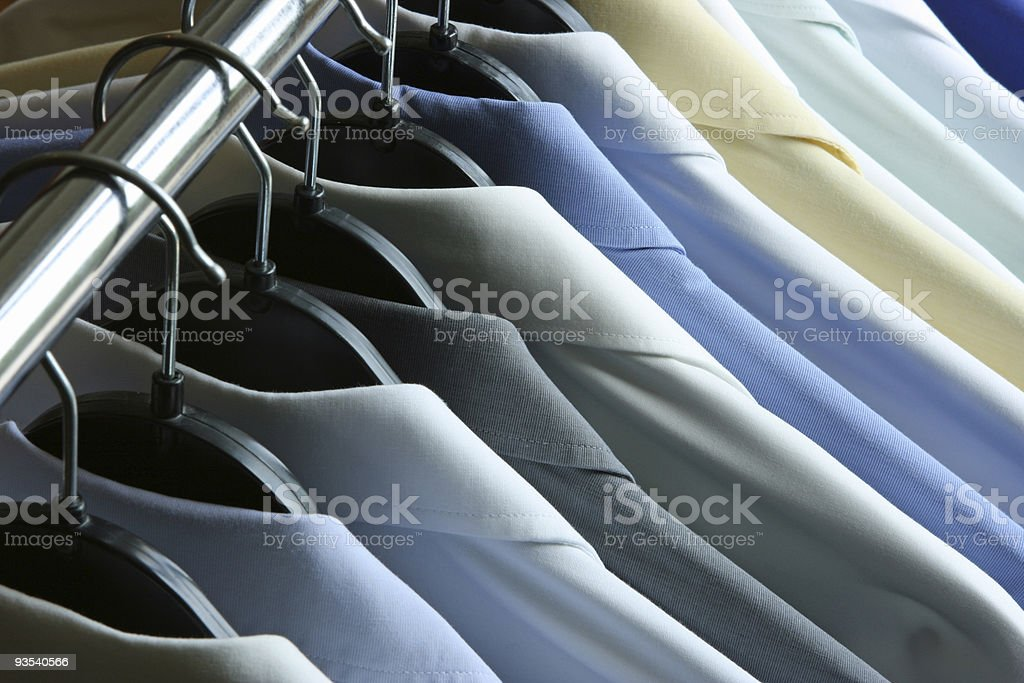 Shirts hanging on the rack - dry cleaner or laundry stock photo