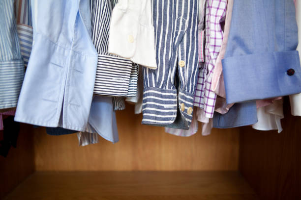 Shirts in a closet stock photo