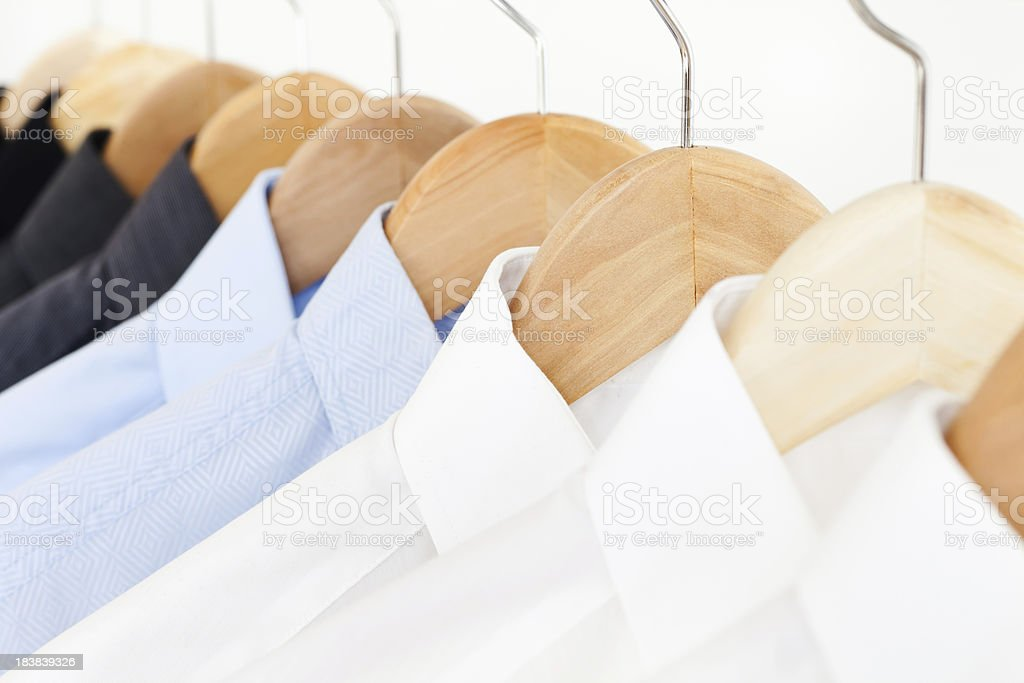 Shirts on hangers in a store. royalty-free stock photo