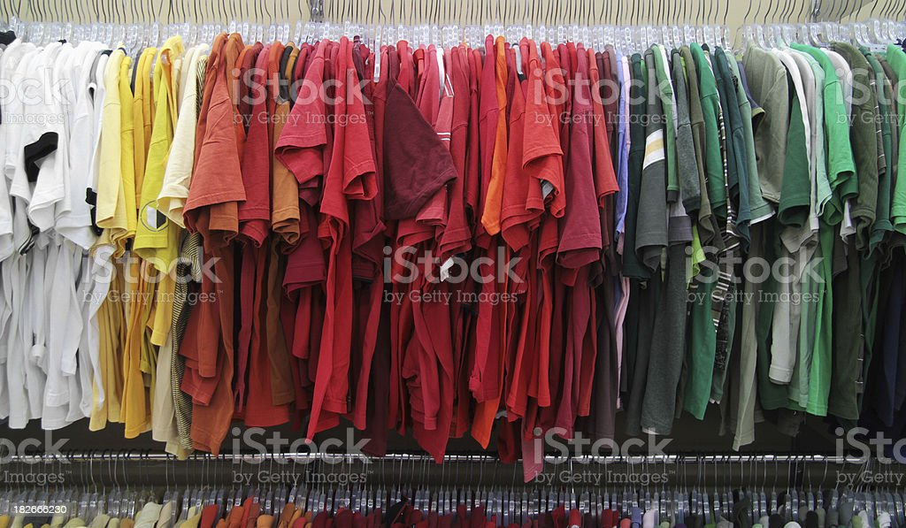 Shirts Organized by Color on Rack royalty-free stock photo