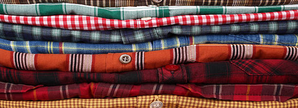 Shirts This is a pile of plaid shirts. plaid shirt stock pictures, royalty-free photos & images