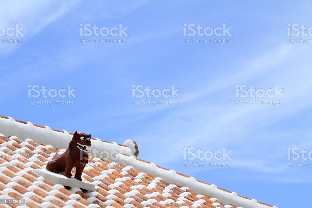 Shisa (guardian from Kingdom of Ryukyu) on the roof in Okinawa, Japan stock photo